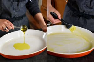 Someone is pouring extra virgin olive oil in a oval casserole pan and brushing it all over