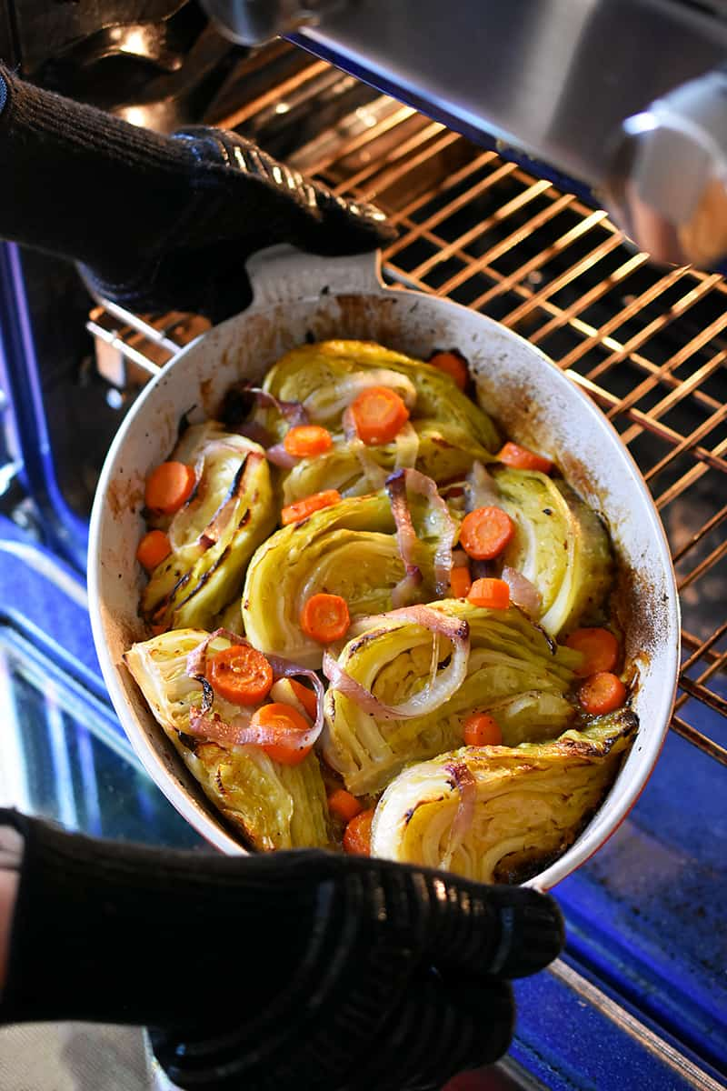 Removing braised cabbage from the oven to serve.