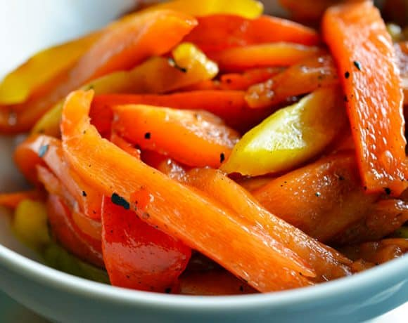 A bowl of paleo roasted bell peppers with balsamic vinegar and extra virgin olive oil.