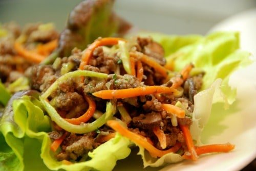 Paleo asian ground beef, mushroom, and broccoli slaw in lettuce cups.