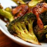 Close up of roasted broccoli and bacon.