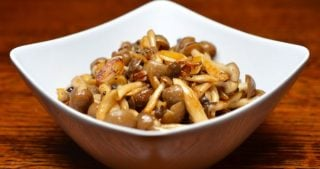 A bowl of paleo spicy sautéed mushrooms with anchovy.