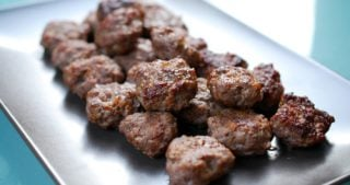 A plate of paleo easy broiled Tabil seasoned beef patties.