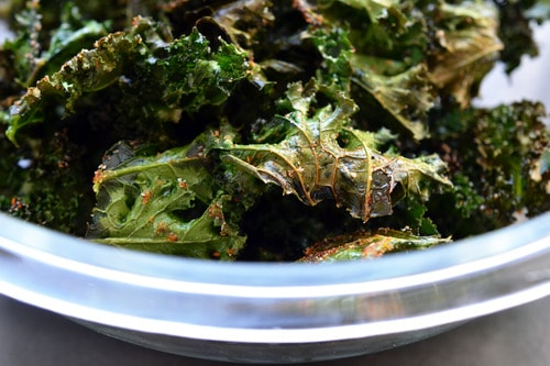 A closeup of a bowl of homemade Baked Kale Chips