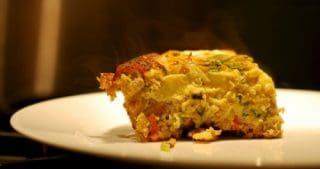 A slice of the paleo and whole30 curried ground pork and broccoli slaw frittata.