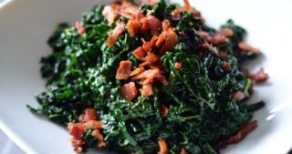 A bowl of paleo stir fried kale and bacon.