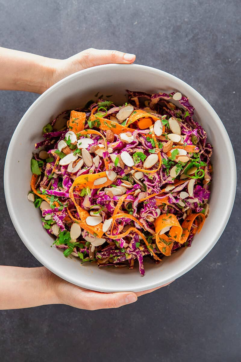 Overhead shot of Whole30 and paleo red cabbage slaw with tangy carrot and ginger dressing