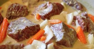 Beef short ribs cooked in a green curry.