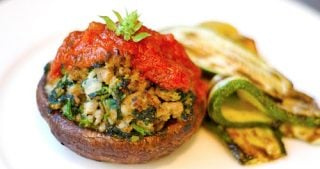 Sausage and spinach stuffed portobello mushrooms.
