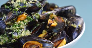 A bowl of thai steamed mussels.