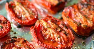 Tray of oven-roasted tomatoes.