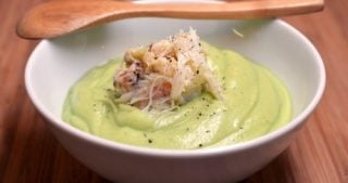 Bowl of chilled cream of avocado soup with dungeness crab