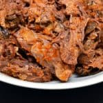 A plate of shredded beef chuck roast.
