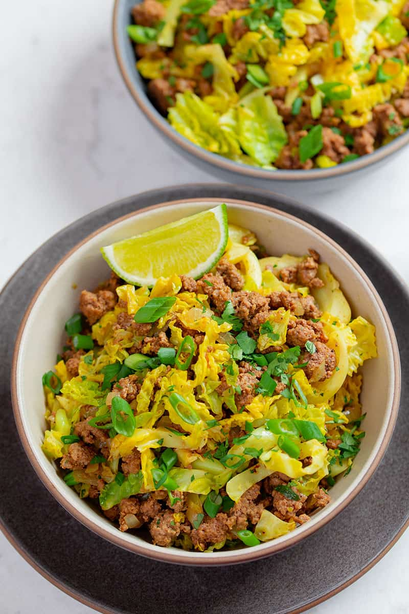 Two bowls of garbage stir fry, and easy and healthy ground beef and curried cabbage dinner.