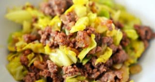 A close up image of a white bowl with Whole30 curried ground beef and cabbage stir-fry.
