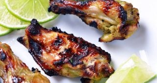 A closeup of Chili Lime Chicken Wings on a platter