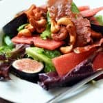 Plate of fig and watermelon salad with honey vanilla cashews