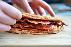 A side view of a Bacon Pancake Sandwich