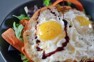 Sunnyside Salad (Crispy Fried Eggs On Greens) by Michelle Tam http://nomnompaleo.com