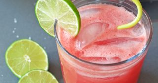 An overhead shot of a glass of healthy Watermelon Coconut Cooler, a tasty Whole30 cocktail.