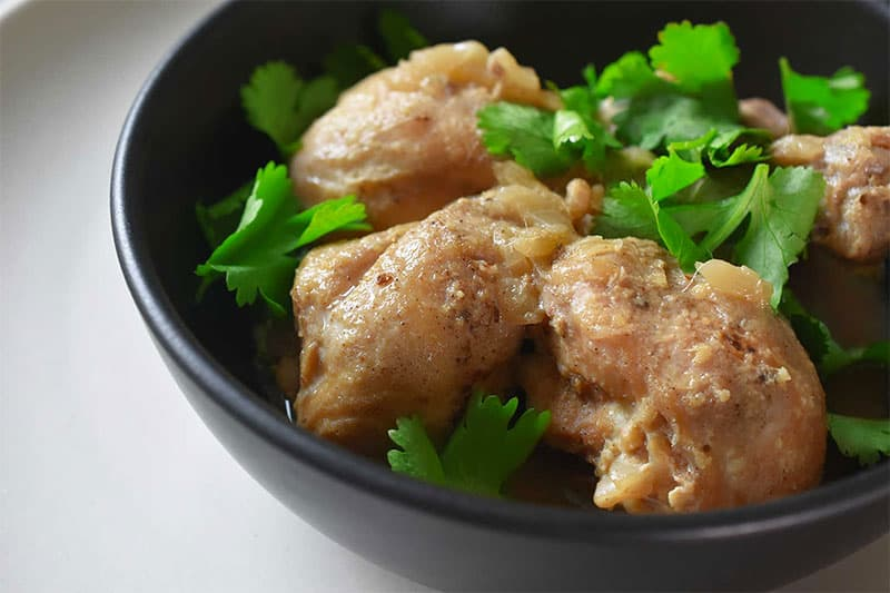 A closeup shot of a bowl of Instant Pot Lemongrass Coconut Chicken