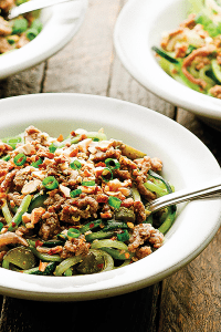 This fast Whole30-friendly Dan Dan Noodles uses zucchini noodles to make it paleo, cornichons for an acidic tang, and a separate chili oil for heat!