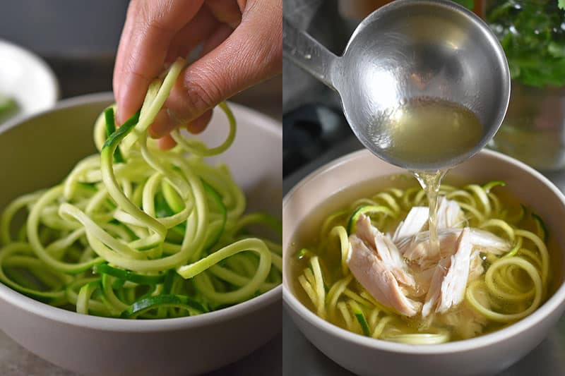 Placing raw zucchini noodles in a bowl and ladling on hot pho broth and shredded chicken