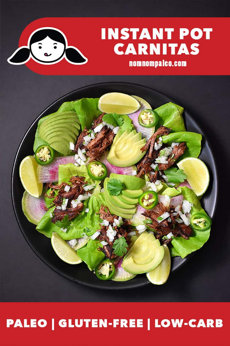 An overhead shot of a platter filled with Nom Nom Paleo Instant Pot Carnitas, lettuce leaves, diced onion, jalapeños, sliced avocados, and lime wedges. There is a red banner at the bottom that says paleo, gluten-free, and low carb
