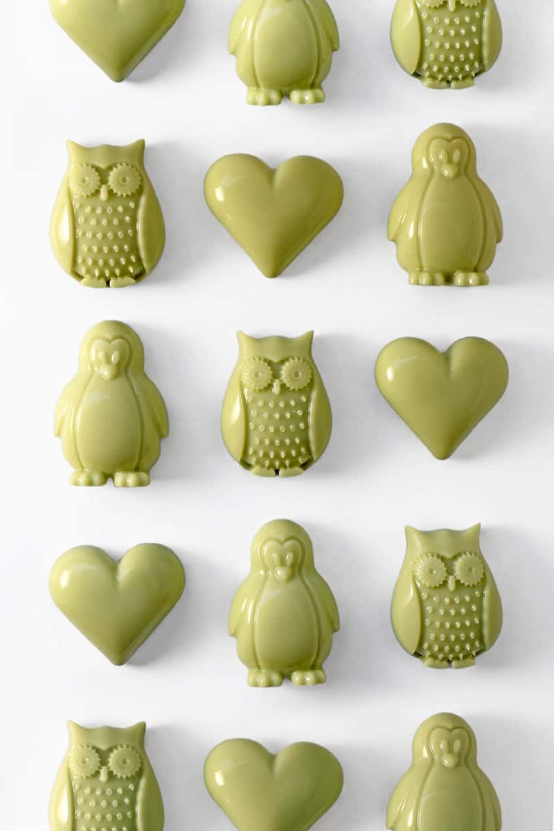 Rows of matcha gummies in the shapes of hearts, penguins, and owls.