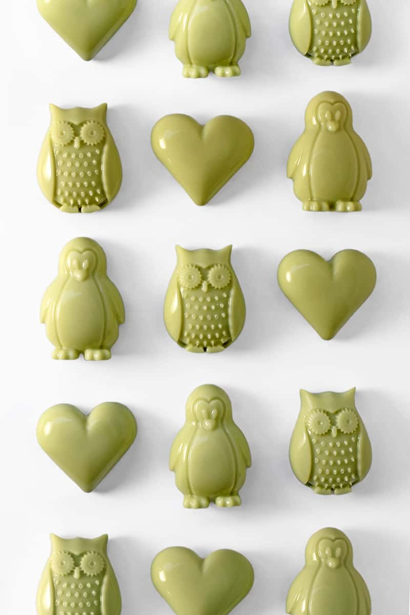 heart and owl-shaped Matcha Coconut Gummies on a white background