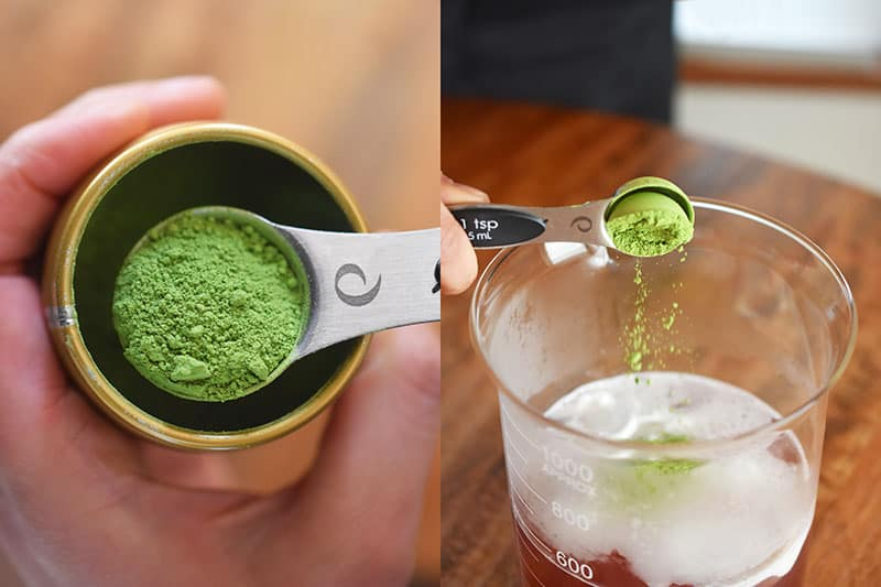 Someone adding matcha into the hot coconut water and coconut cream mixture.