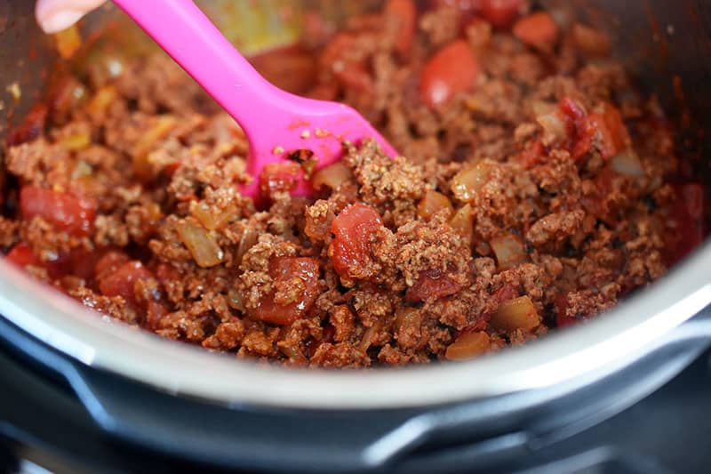 An image of Instant Pot Ground Beef Chili right before it is cooked under pressure. The meat is browned and the vegetables are tender.