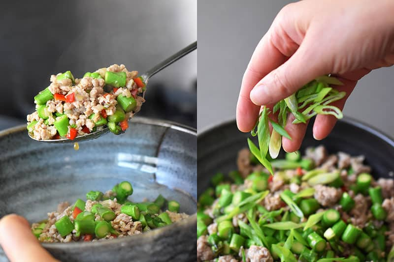 Transferring the Spicy Pork and Asparagus Stir-Fry to a serving bowl and topping it with sliced scallions