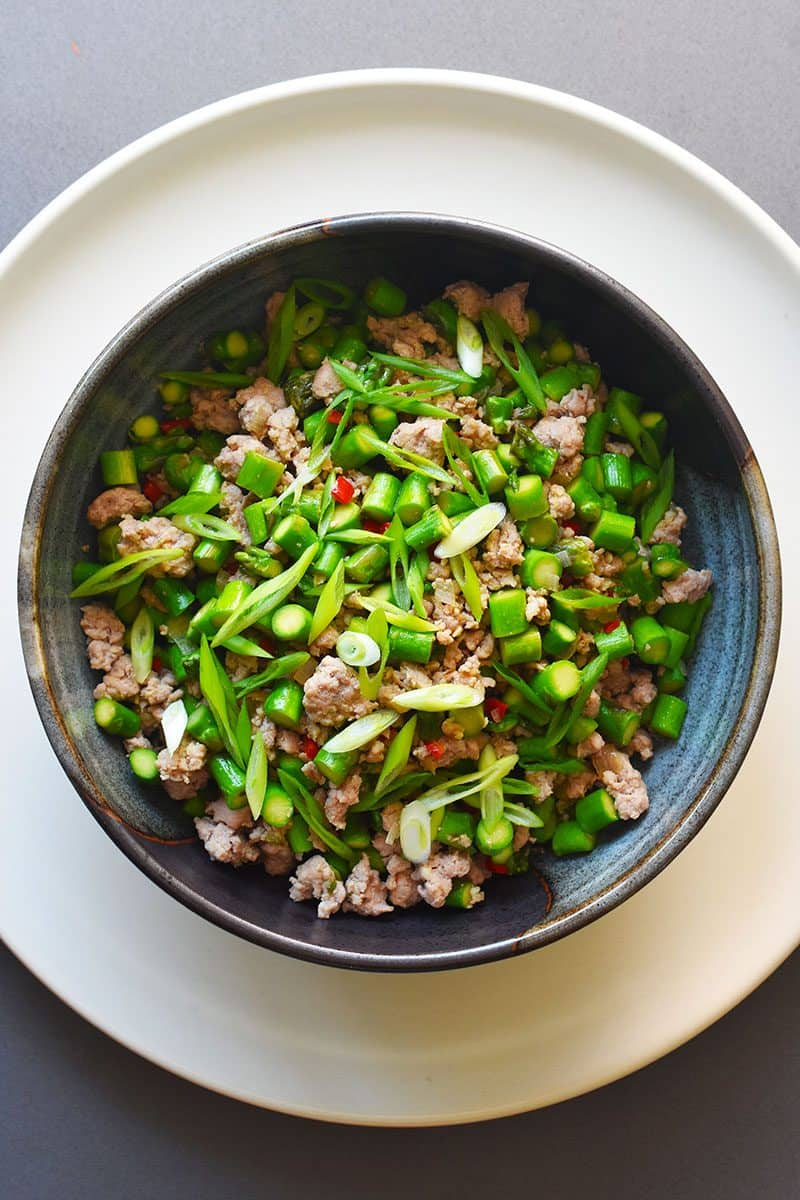 An overhead shot of Spicy Pork and Asparagus Stir-Fry in a serving bowl