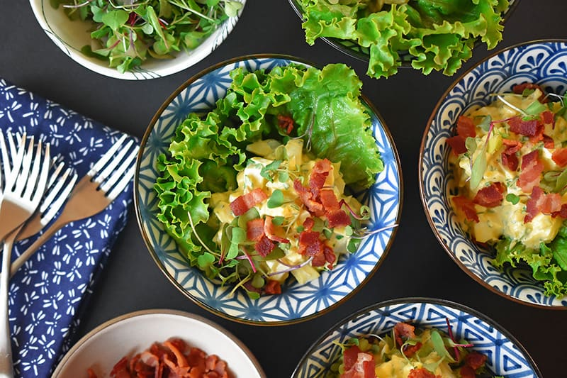 An overhead shot of Bacon Deviled Egg Salad divided into serving bowls.