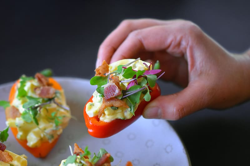 Bacon Deviled Egg Salad in small hollowed red bell peppers.