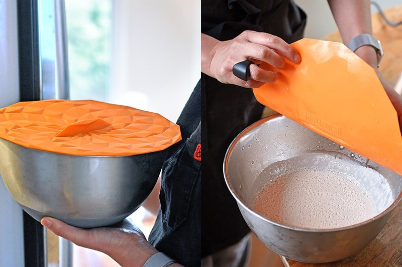 Placing a silicone lid onto of a metal bowl filled with Paleo vanilla Pudding