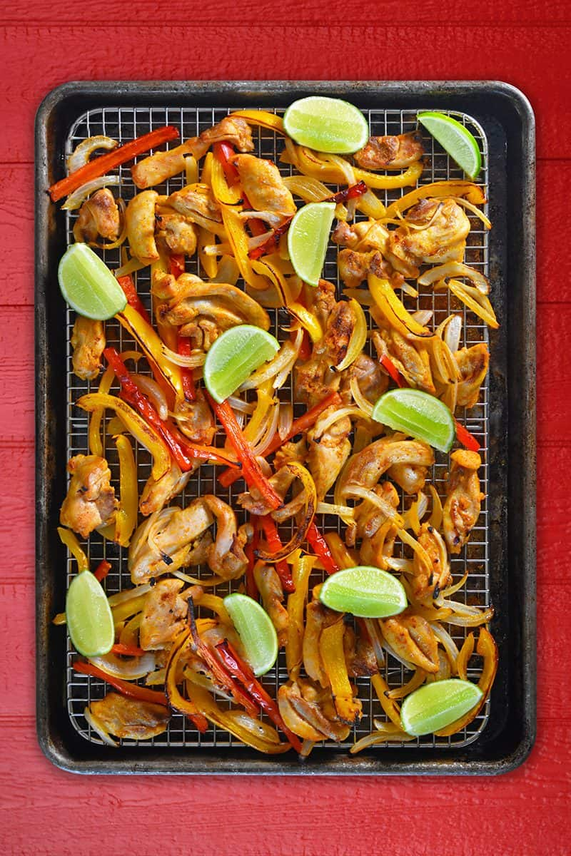 An overhead shot of Sheet Pan Chicken Fajitas + Avocado Crema