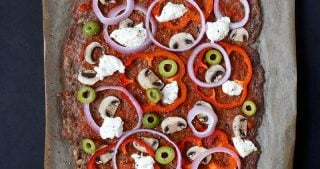 An overhead shot of Nom Nom Paleo's Meatza fresh from the oven.