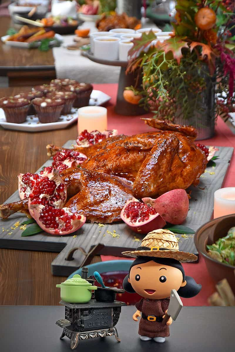 A shot of a Paleo Thanksgiving table with a spatchcock turkey and all the side dishes.