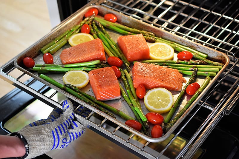 Cooking a Sheet Pan Salmon Supper in the oven.