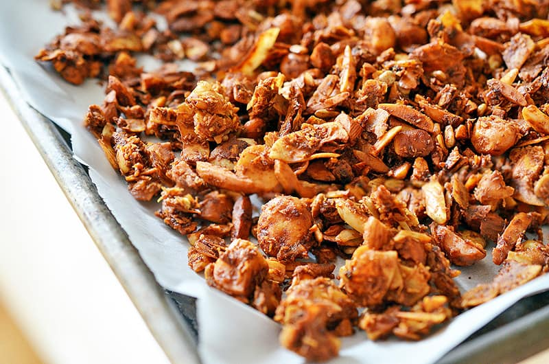 A closeup of a tray of paleo tropical granola fresh out of the oven.