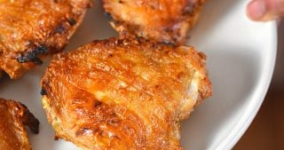 A close up shot of Umami Roast Chicken on a white platter