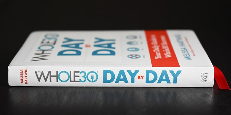 A side view of the Whole30 Day By Day journal.
