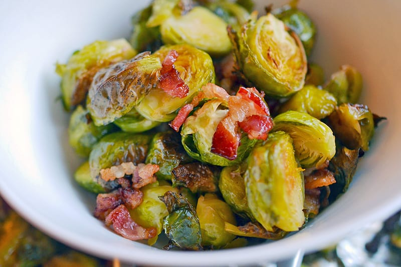 A white bowl filled with Roasted Brussels Sprouts and Bacon