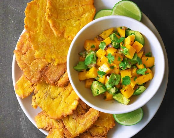 An overhead shot of Fried Green Plantains + Mango Avocado Salsa.