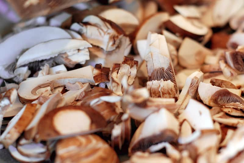 A closeup of thinly sliced mushrooms.