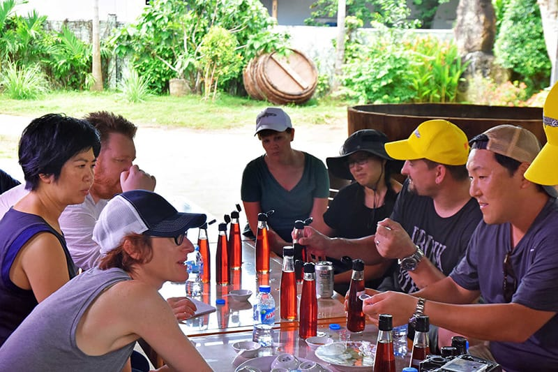 A shot of famous chefs tasting Red Boat fish sauce in Vietnam