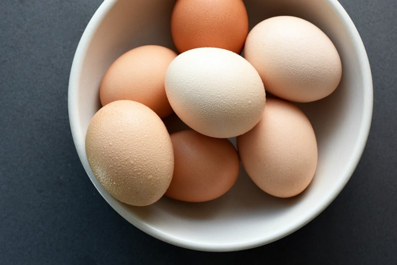 Overhead shot of a bowl of brown eggs.