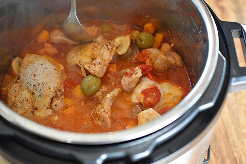 An open Instant Pot filled with Whole30 Summer Italian Chicken stew.